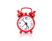 Red vintage alarm clock islolated on white background Royalty Free Stock Photos