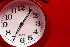 A red vintage alarm clock on a red background Stock Photography