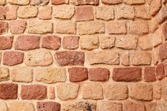 Red vintage brick wall background. Uneven vintage bricks. Colonial bricks royalty free stock images