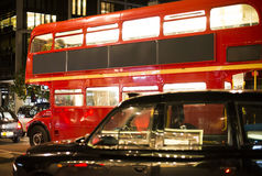 Red vintage bus and classic style taxi in London. Royalty Free Stock Photos