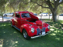 Red vintage car. Red vintage collector's car at a car show, frontal view Stock Photo