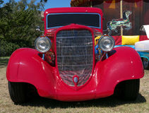 Red vintage car. Red vintage collector's car at a car show, frontal view Royalty Free Stock Photo