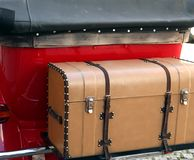 Vintage car with luggage and an old trunk. Red vintage car with luggage and an old trunk Stock Photos