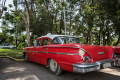 Red vintage car parked in Cuba Stock Photography