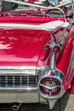 Red Vintage Car Rear. Vintage red car rear rocket lights Royalty Free Stock Photography