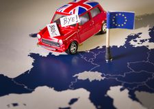 Red vintage car with Union Jack flag and brexit or bye words over an UE map and flag. Stock Image