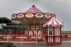 Red vintage carousel in attraction park or on a carnival Royalty Free Stock Photos