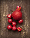 Red Vintage Christmas Balls and Gifts on Wooden Background Stock Photography