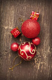 Red Vintage Christmas Balls and Gifts on Wooden Background Royalty Free Stock Photography