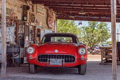 Red vintage Corvette at Hackberry's General Store. Hackberry, Arizona, USA - June 11th 2014. Red vintage Corvette at Hackberry's General Store. Hackberry is Stock Photo