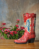 Red vintage cowboy boot on wood Royalty Free Stock Images