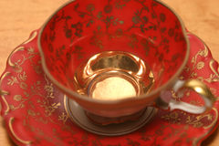 Red vintage cup. Close up of an antique coffee cup Stock Photography