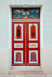 Red vintage door on a old building facade in old Tallinn city Royalty Free Stock Photo