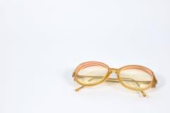 Red vintage eye-glasses on background. Stock Image