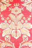 Red vintage fabric with gold decor Royalty Free Stock Photo