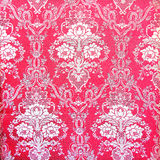 Red vintage fabric with gold decor Stock Photo