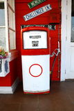 Red vintage gasoline pump over white background Royalty Free Stock Image