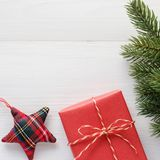 Red vintage gift box and ornament on white wood background with copy space, Christmas, new year, valentine`s day and anniversary. Greeting card background royalty free stock images