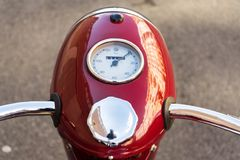 Red vintage motorcycle Jawa 125 produced in former Czechoslovakia. Detail of red vintage motorcycle Jawa 125 produced in former Czechoslovakia Royalty Free Stock Photo