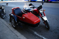Red vintage motorcycle with sidecar Royalty Free Stock Images