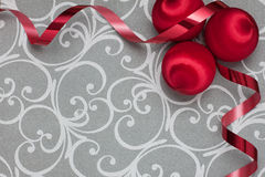 Red vintage ornaments with ribbon on silver Royalty Free Stock Image