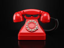 Red vintage phone on black background Stock Photo