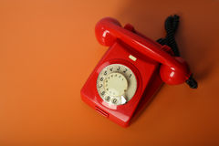 Red vintage phone on a orange background Stock Photography