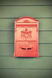 Red vintage post box on wooden Royalty Free Stock Images