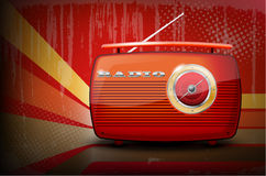 Red vintage radio on retro stripe background Stock Photography