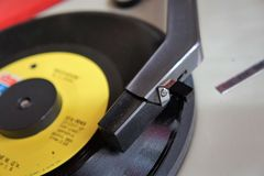 Vintage record player with vinyl disc stock photography