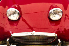 Red vintage sports car front bonnet headlights Stock Photo