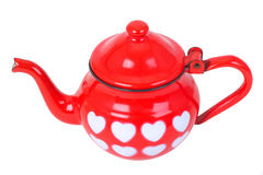 Red vintage teapot with painted hearts. Isolated on white Royalty Free Stock Photo