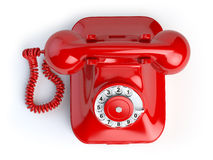 Red vintage telephone  on white. Top view of phone Royalty Free Stock Photo