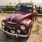 Red vintage Topolino car. Verona, Italy - September 27, 2014: Topolino Autoclub Italia organizes a gathering on Lake Garda. Cars and enthusiasts from all over Stock Image