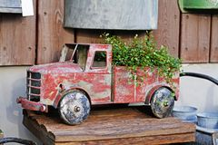 Vintage toy truck with plant in a flower shop. Red vintage toy truck with plant in a flower shop royalty free stock images
