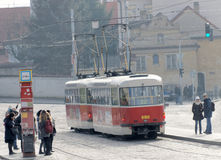 Red vintage tram and people waiting Stock Photos