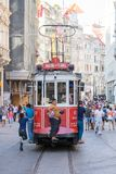 Red vintage tram on Taksim square in Istanbul, Turkey Stock Photo
