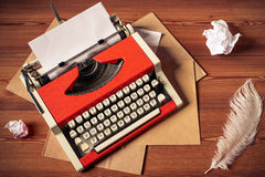 Red vintage typewriter with white blank paper sheet Royalty Free Stock Photo