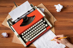 Red vintage typewriter with white blank paper sheet Royalty Free Stock Photos