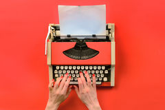 Red vintage typewriter with white blank paper sheet Royalty Free Stock Images