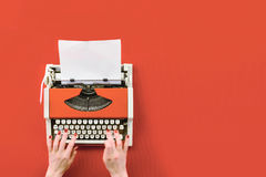 Red vintage typewriter with white blank paper sheet Royalty Free Stock Photography