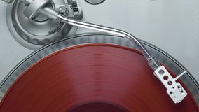 Red vinyl record on the turntable player top view stock video