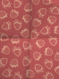 Red vintage wrapping paper with strawberries Stock Photos
