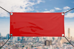 Red vinyl banner. Red blank vinyl banner hanging with rope royalty free stock photo