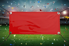 Red vinyl banner. Red blank vinyl banner hanging with rope stock image