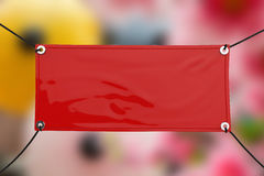 Red vinyl banner. Red blank vinyl banner hanging with rope royalty free stock photography