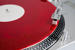 Red vinyl record on the player Royalty Free Stock Photography