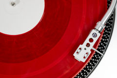 Red vinyl record on the player Stock Photos