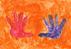 Red and violet hands on the orange background. Children's picture of my son when he was 3,5 years old Royalty Free Stock Photography