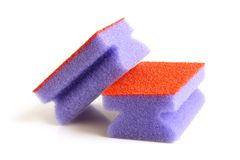 Red and violet sponges. On a white background Stock Photo